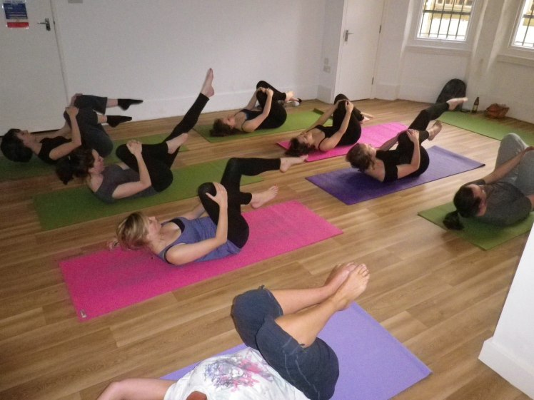 A group practise Pilates at Officreche, Brighton.