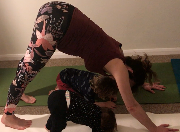 Kat Frost of Yoga2shape does downward dog pose with two toddlers in a children's yoga class (YogaShapes).